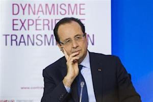 French President Francois Hollande attends a meeting for the signing of the first contracts of generations partnership between the State and the company Solvay in Aubervilliers