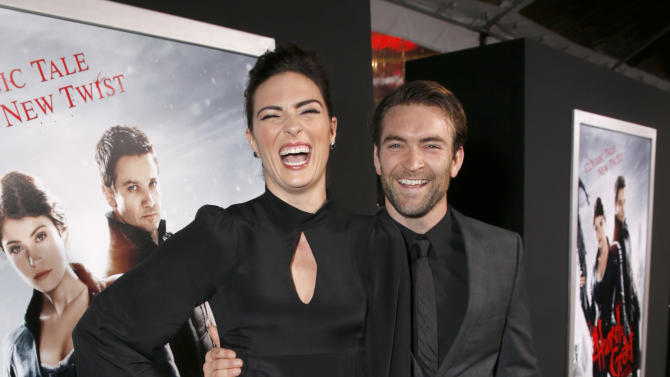"""Monique Ganderton and Fight Arranger Sam Hargrave arrive at the premiere of """"Hansel & Gretel Witch Hunters"""" on Thursday Jan. 24, 2013, in Los Angeles.  (Photo by Todd Williamson/Invision/AP)"""