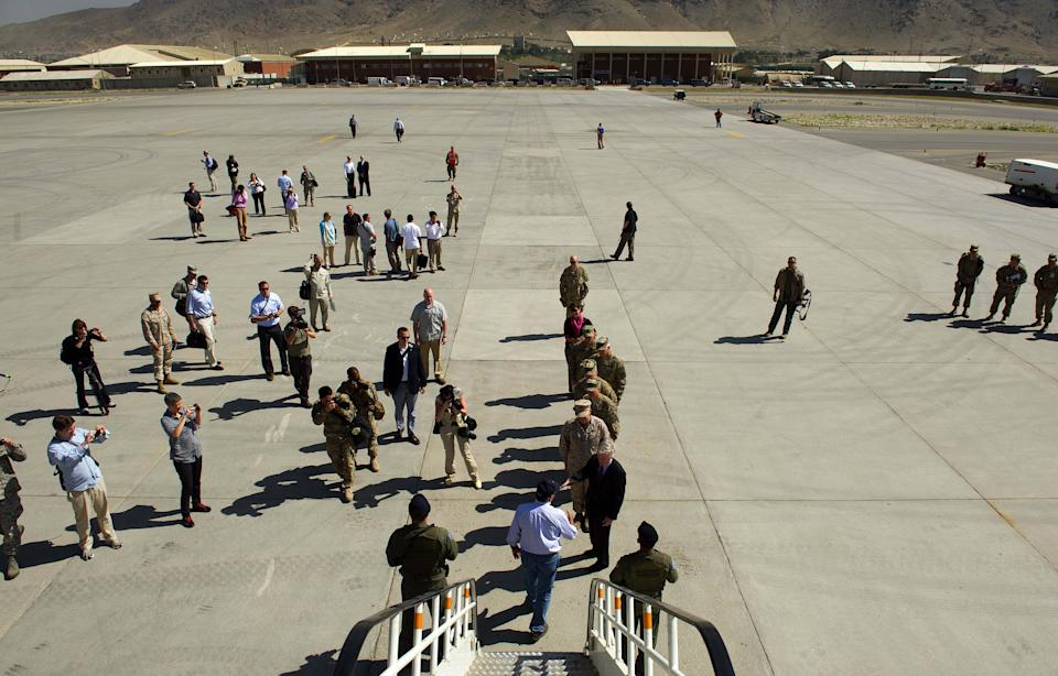 U.S. Defense Secretary Leon Panetta, center at the bottom, arrives at Kabul International Airport in Kabul, Afghanistan Thursday, June 7, 2012. Panetta arrived in Afghanistan on Thursday to take stock of progress in the war and discuss plans for the troop drawdown, even as violence spiked in the south. (AP Photo/Jim Watson, Pool)