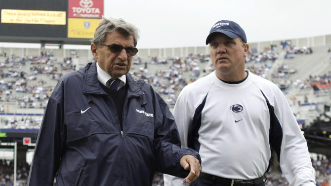FILE - In this Sept. 12, 2009, file photo, Penn State coach Joe Paterno, left, walks with assistant coach Tom Bradley on the field before an NCAA college football game against Syracuse in State College, Pa. Penn State trustees have chosen Bradley as interim head coach for the remainder of the season in the wake of firing Paterno and university president Graham Spanier amid the growing furor over how the school handled sex abuse allegations against an assistant coach, Wednesday, Nov. 9, 2011. (AP Photo/Carolyn Kaster, File)