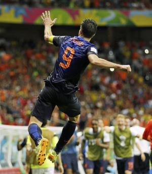 Netherlands' Robin van Persie celebrates after his scoring his side's fourth goal during the second half of the group B World Cup soccer match between Spain and the Netherlands at the Arena Ponte Nova in Salvador, Brazil, Friday, June 13, 2014. (AP Photo/Natacha Pisarenko)