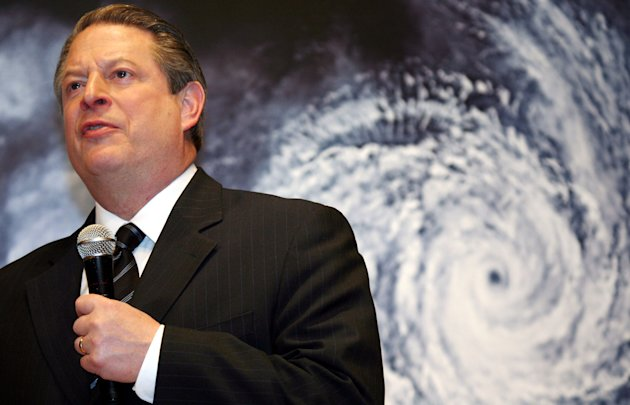 "FILE - In this Monday, Jan. 15, 2007 file photo, former U.S. Vice President Al Gore speaks in front of a poster for his documentary film on global warming, ""An Inconvenient Truth,"" during the Japanese premier in Tokyo. On Wednesday, Nov. 14, 2012, Gore will launch a 24-hour online talkfest about global warming and disasters. Superstorm Sandy, the rare and devastating Northeast storm, and an election that gave Democrats gains have put global warming back in the picture. (AP Photo/Koji Sasahara)"