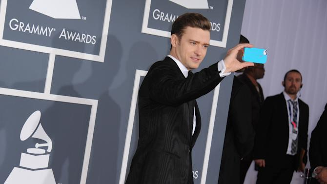 Musician Justin Timberlake arrives at the 55th annual Grammy Awards on Sunday, Feb. 10, 2013, in Los Angeles.  (Photo by Jordan Strauss/Invision/AP)