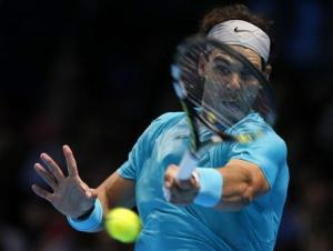 Nadal of Spain hits a return during his men's singles …