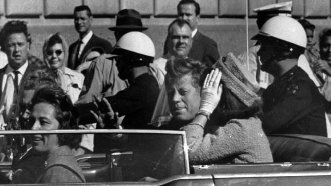 President John F. Kennedy rides in the motorcade in Dallas moments before his assassination on Nov. 22, 1963.