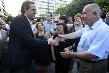 Conservative New Democracy party leader Samaras is greeted by supporters outside an election campaign kiosk in central Athens