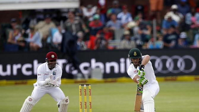 South African batsman Faf du Plessis (R) plays a shot during the 1st day of the second test match between South Africa and the West Indies at St.George Park in Port Elizabeth on December 26, 2014