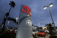 <p>               In this Thursday, Nov. 8, 2012, photo, a Toyota dealership signs glows over a car lot in Tustin Calif. A better economy and extra demand after Superstorm Sandy lifted U.S. auto sales in November. (AP Photo/Chris Carlson)