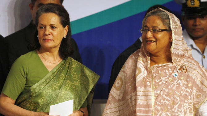 Bangladesh's Prime Minister Sheikh Hasina, right, and India's ruling Congress party president Sonia Gandhi arrive for an international Autism conference in Dhaka, Bangladesh, Monday, July 25, 2011. (AP Photo/ Pavel Rahman)