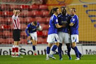 Jason Scotland (centre) has scored 19 goals for Ipswich