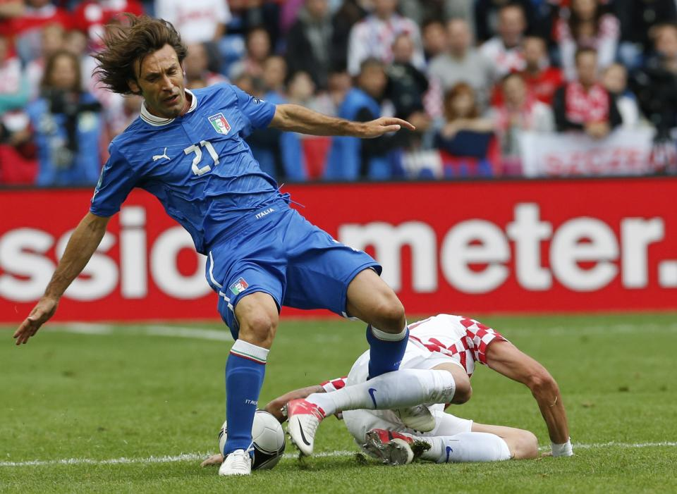 Italy's Andrea Pirlo, left, is fouled by Croatia's Mario Mandzukic during the Euro 2012 soccer championship Group C match between Italy and Croatia in Poznan, Poland, Thursday, June 14, 2012. (AP Photo/Antonio Calanni)