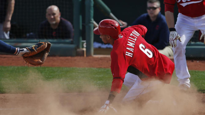 Cincinnati Reds' Billy Hamilton slides safely into home in the fifth inning of a spring training exhibition baseball game against the Cleveland Indians, Tuesday, March 3, 2015, in Goodyear, Ariz. (AP Photo/John Locher)