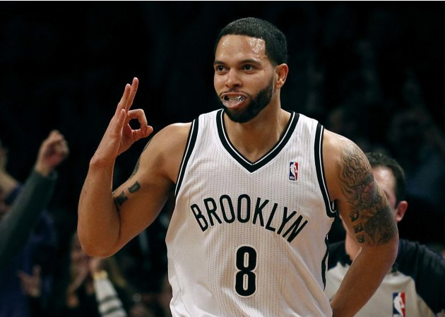 Brooklyn Nets point guard Deron Williams reacts after hitting a three-point shot against the Washington Wizards in the first quarter of their NBA basketball game in New York