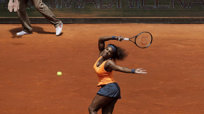 Serena Williams from U.S. returns the ball during the match against Maria Kirilenko from Russia at the Madrid Open tennis tournament, in Madrid, Thursday, May 9, 2013. (AP Photo/Andres Kudacki)