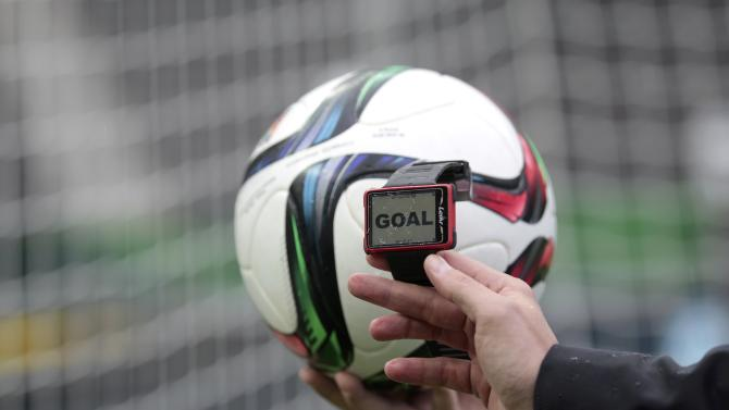 A technician checks the Hawk-Eye goal control system before its first official use at the German Cup (DFB Pokal) final soccer match between Borussia Dortmund and VfL Wolfsburg in Berlin