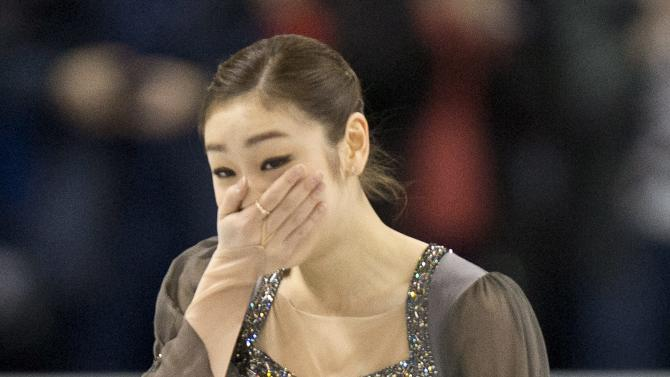 Gold medalist Kim Yu-na from South Korea reacts at the end of her free program at the World Figure Skating Championships Saturday, March 16, 2013 in London, Ontario. (AP Photo/The Canadian Press, Paul Chiasson)