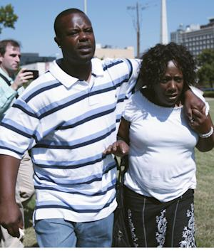 "Ablene Cooper, right,and her son Antonio Cooper,  leave the  Hinds County courtroom in Jackson, Miss., Tuesday, Aug. 16, 2011, after a circuit judge dismissed her lawsuit against Kathryn Stockett, author of the best-selling novel ""The Help.""    ""The Help"" was made into a movie that opened last week. It's based on relationships between white families and the African-American women who worked for them in the 1960s. The lawsuit was filed by  Cooper,  who works for Stockett's brother. She claims a main character, Aibileen, is based on her. Cooper accuses Stockett of using her name and likeness without permission. (AP Photo/Rogelio V. Solis)"