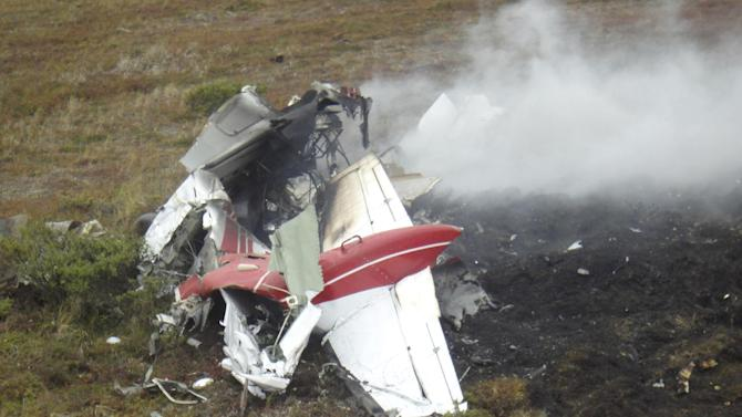 In this handout photo provided by the Alaska State Troopers Bethel Post, the crashed plane flown by Scott Veal is shown on Friday, Sept. 2, 2011, near Nightmute, Alaska. A preliminary report says the surviving pilot of a fatal midair collision in Alaska made an emergency landing as her plane's stall warning sounded. The National Transportation Safety Board says Kristen Sprague thought her Cessna 207 would crash after the aircraft's right wing was struck by a Cessna 208 Caravan flown by her 24-year-old boyfriend, Scott Veal, of Kenai. (AP Photo/Alaska State Troopers Bethel Post, handout)