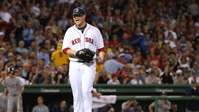 Boston Red Sox starting pitcher Jon Lester yells after striking out Tampa Bay Rays' James Loney to end the top of the fourth inning of a baseball game at Fenway Park in Boston on Tuesday, July 23, 2013. (AP Photo/Elise Amendola)