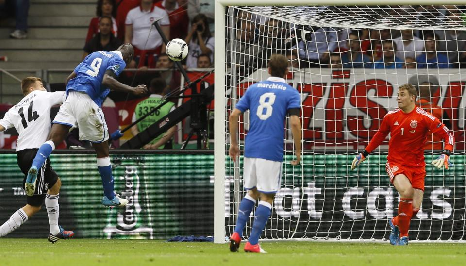 Italy's Mario Balotelli, second left,  scores during the Euro 2012 soccer championship semifinal match between Germany and Italy in Warsaw, Poland, Thursday, June 28, 2012. (AP Photo/Frank Augstein)