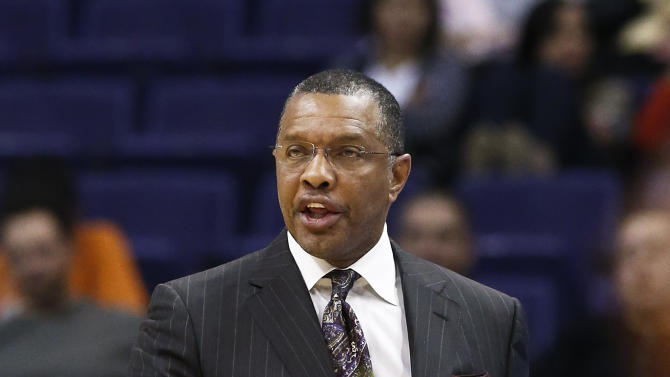"""In this photo taken Thursday, Jan. 17, 2013, Phoenix Suns' head coach Alvin Gentry argues with officials during an NBA basketball game against the Milwaukee Bucks, in Phoenix.  After five-plus seasons, Gentry is stepping down as head coach today as Gentry and the team """"have mutually agreed to part ways"""" according to team officials.(AP Photo/Ross D. Franklin)"""