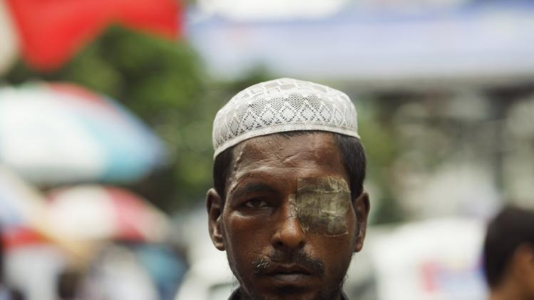 A Muslim man arrives to offer Friday prayers in front of Baitul Mukarram, Bangladesh's national mosque, during the holy fasting month of Ramadan in Dhaka