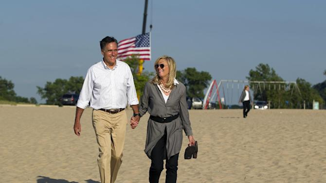 Republican presidential candidate, former Massachusetts Gov. Mitt Romney, left, takes a walk with his wife Ann, on the beach after a campaign stop at Holland State Park on Tuesday, June 19, 2012 in Holland, Mich.  (AP Photo/Evan Vucci)