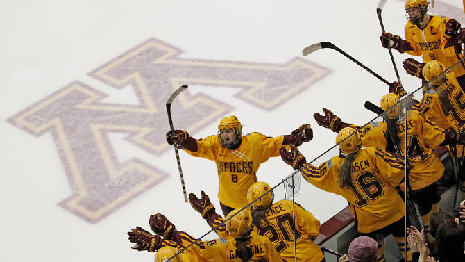 Minnesota forward Amanda Kessel (8) celebrates with her team after making a goal against Boston University in the women's Frozen Four NCAA Championship college hockey game, Sunday, March 24, 2013, in Minneapolis. Minnesota won 6-3. (AP Photo/Stacy Bengs)