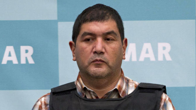 """The alleged leader of a faction of the hyper-violent Zetas cartel, Ivan Velazquez Caballero, known as """"El Taliban,""""  is shown during a media presentation at the Mexican Navy's Center for Advanced Naval Studies in Mexico City,Thursday, Sept. 27, 2012. Velazquez Caballero allegedly has been fighting a bloody internal battle with top Zetas' leader Miguel Angel Trevino Morales, and officials have said the split was behind a recent surge in massacres and shootouts, particularly in northern Mexico. (AP Photo/Eduardo Verdugo)"""