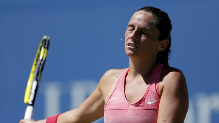 Vinci of Italy reacts after a missed point against compatriot Pennetta at the U.S. Open tennis championships in New York