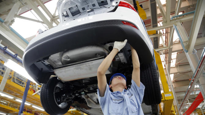 FILE - In this Tuesday, April 16, 2013, photo, a worker assembles a vehicle on an assembly line at Ford factory in Chongqing, China Tuesday, April 16, 2013. Ford Motor Co. reports quarterly financial results before the market opens on Wednesday, April 24, 2013.  (AP Photo/File)