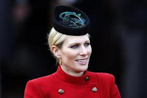 Britain's Zara Phillips smiles in the unsaddling enclosure on Ladies Day at the Cheltenham Festival horse racing meet in Gloucestershire