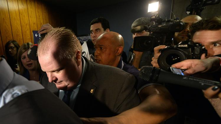 Toronto Mayor Rob Ford returns following a break in an executive committee meeting at City Hall in Toronto
