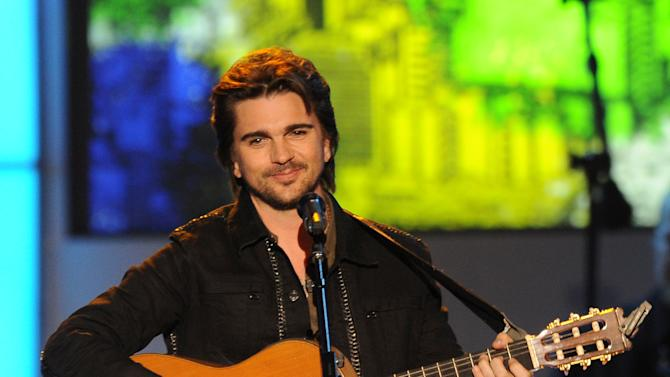 """Juanes performs """"Sampa"""" at the 2012 Latin Recording Academy Person of the Year Tribute to Caetano Veloso at the MGM Grand Garden Arena on Wednesday, Nov. 14, 2012, in Las Vegas. (Photo by Powers Imagery/Invision/AP)"""