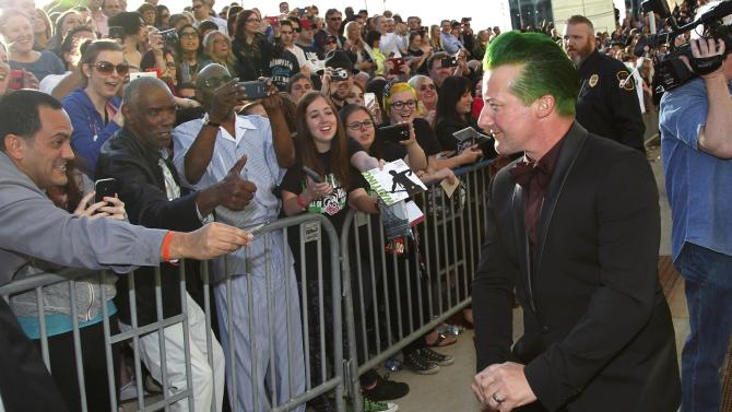 Green Day drummer Tre Cool walks next to fans as he arrives for the 2015 Rock and Roll Hall of Fame Induction Ceremony in Cleveland