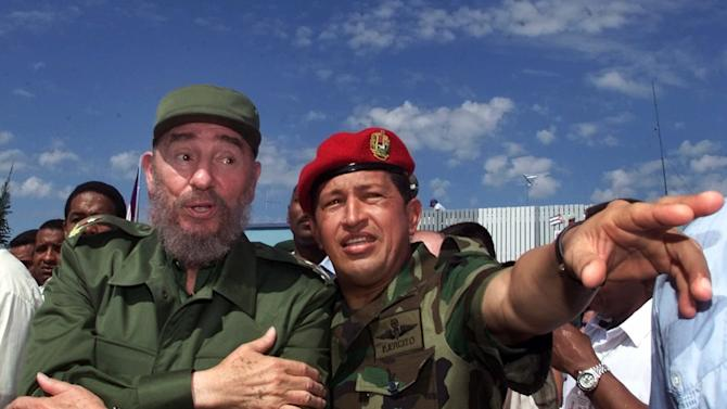 FILE - In this Oct. 28, 2000 file photo, Cuba's President Fidel Castro, left, talks with Venezuela's President Hugo Chavez in Barinas, Venezuela, near Chavez's hometown of Sabaneta. Venezuela's Vice President Nicolas Maduro announced on Tuesday, March 5, 2013 that Chavez has died.  Chavez, 58, was first diagnosed with cancer in June 2011. (AP Photo/Jose Goitia, File)