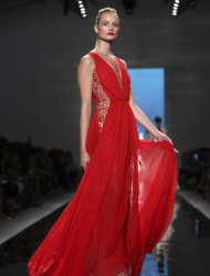 The Reem Acra Spring 2013 collection is modeled during Fashion Week in New York, Monday, Sept. 10, 2012. (AP Photo/Seth Wenig)