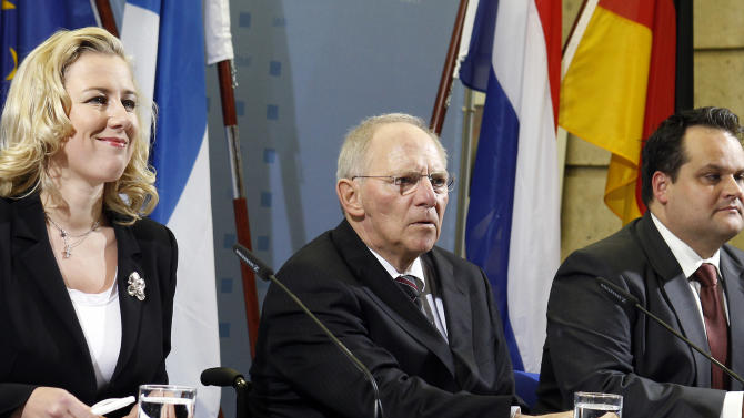 """German Finance Minister Wolfgang Schaeuble, center, the Finance Minister of the Netherlands, Jan Kees de Jager, right, and the Finance Minister of Finland, Jutta Urpilainen, left,  attend a  news conference  in Berlin, Germany, Friday, Nov. 25, 2011. The finance ministers of Germany, the Netherlands and Finland say they favor an """"enhanced and strengthened"""" role for the International Monetary Fund as they seek to boost Europe's defenses against the debt crisis. The three ministers met to prepare for a meeting with other eurozone colleagues next Tuesday.  (AP Photo/Michael Sohn)"""