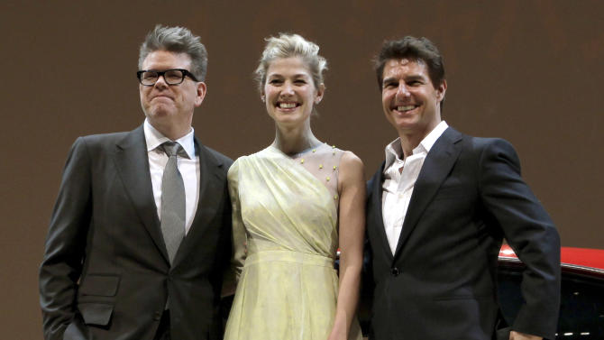 "U.S. actor Tom Cruise, right, British actress Rosamund Pike, center, and director Christopher McQuarrie pose for photographers during the Japan premiere of their new movie ""Jack Reacher"" in Tokyo,  Wednesday, Jan. 9, 2013. (AP Photo/Shizuo Kambayashi)"