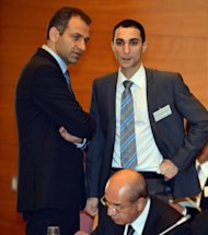 Syrian Economic Task Force representative Abrahim Miro (L) chats with Syrian Economic Task Force officer Ismael Darwish before the opening session of the 5th meeting of the 'Friends of Syria' group in Tokyo, on November 30
