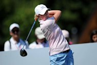 US professional golfer Stacy Lewis hits a drive during the Evian Masters Golf Tournament in Evian-les-Bains, French Alps. Lewis shot a course record 63 in the opening round of the Evian Masters in France on Thursday, her scorching form matching the 30-degree heat
