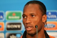 Didier Drogba (pictured in May) arrives in China this weekend amid a spending spree on foreign talent that football chiefs hope will give the local league a much-needed boost but critics say is ruining the sport. The former Chelsea striker will join his new team, Shanghai Shenhua, on Saturday, making him the highest-profile overseas player in the Chinese Super League