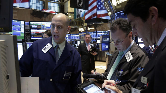 Specialist Meric Greenbaum, left, works at his post on the floor of the New York Stock Exchange Tuesday, Jan. 29, 2013. Stocks opened mixed on Wall Street, with the Standard & Poor's 500 holding at 1,500. (AP Photo/Richard Drew)