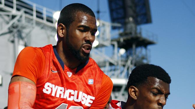 San Diego State's  Winston Shepard battles Syracuse's James Southerland for a loose ball during the first half of an NCAA college basketball game on the deck of the USS Midway, Sunday, Nov. 11, 2012, in San Diego. (AP Photo/Lenny Ignelzi)