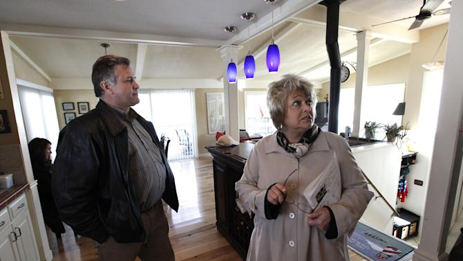 In this Tuesday, April 2, 2013, photo, Sam and Liz Weidner, of Hudsonville, Mich., view a home for sale in Lowell, Mich. The National Association of Realtors reports on sales of previously occupied homes in April on Wednesday, May 22, 2013. (AP Photo/Paul Sancya)