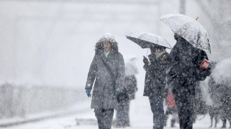 Commuters wait on a train during a winter snowstorm Tuesday, Dec. 10, 2013, in Philadelphia. Accumulations of 3 to 6 inches were expected as the National Weather Service issued a winter storm warning for the Eastern Seaboard, including Baltimore, Washington, D.C., Philadelphia and Wilmington, Del. (AP Photo/Matt Rourke)