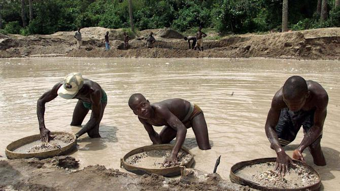 FILE In this May 24, 2000 file photo, diamond prospectors sift through the earth in the Corbert mine in Waiima, Sierra Leone, 40 kilometers (25 miles) east of Bo in central Sierra Leone. On Thursday, April 26, 2012, judges at an international war crimes court will pass judgment on warlord-turned-Liberian president Charles Taylor, who is accused of sponsoring rebels responsible for untold atrocities during Sierra Leone's brutal civil war in return for so-called blood diamonds. The historic verdicts at the Special Court for Sierra Leone will mark the first time an international tribunal has reached judgment in the trial of a former head of state since Nuremberg. (AP Photo/Adam Butler, File)