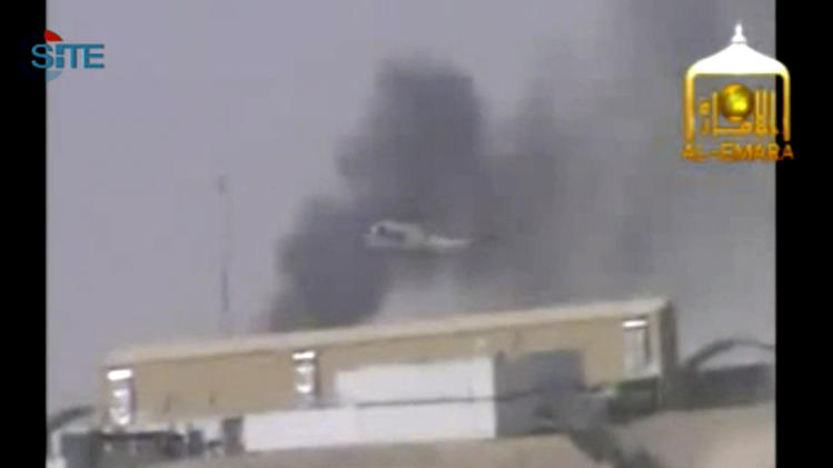 This image from video AP obtained from the SITE Intel Group posted by al-Emarah Jihadi Studio, an Afghan Taliban media unit who released two clips on Saturday, Sept. 15, 2012, purports to show smoke rising over Camp Bastion in Helmand Province, Afghanistan after what the Taliban media unit says is an attack at the base. The Taliban claimed responsibility Saturday for the attack on a sprawling British base in southern Afghanistan that killed two U.S. Marines and wounded several other troops, saying it was to avenge an anti-Islamic film that insulted the Prophet Muhammad and also because Britain's Prince Harry is serving there. This photo, which AP obtained from SITE Intelligence Group, has been authenticated based on its contents and other AP reporting. (AP Photo/SITE Intelligence Group) MANDATORY CREDIT