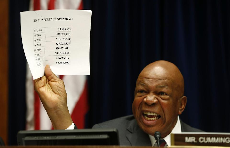 Rep. Elijah Cummings, D-Md., ranking Democrat on the House Oversight and Government Reform Committee, holds up a sheet detailing IRS conference spending as he makes opening remarks on Capitol Hill in Washington, on Thursday, June 6, 2013, during the committee's hearing regarding IRS conference spending.  (AP Photo/Charles Dharapak)