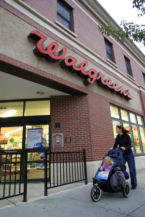 Walgreen fiscal 2Q profit slides nearly 8 percent